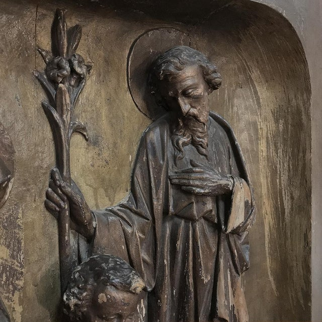 19th Century Carved Panel of the Holy Family was sculpted from a solid block of walnut then given a polychrome finish...