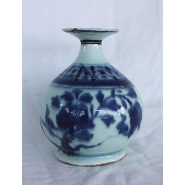 Chinese blue and white ceramic bud vase.