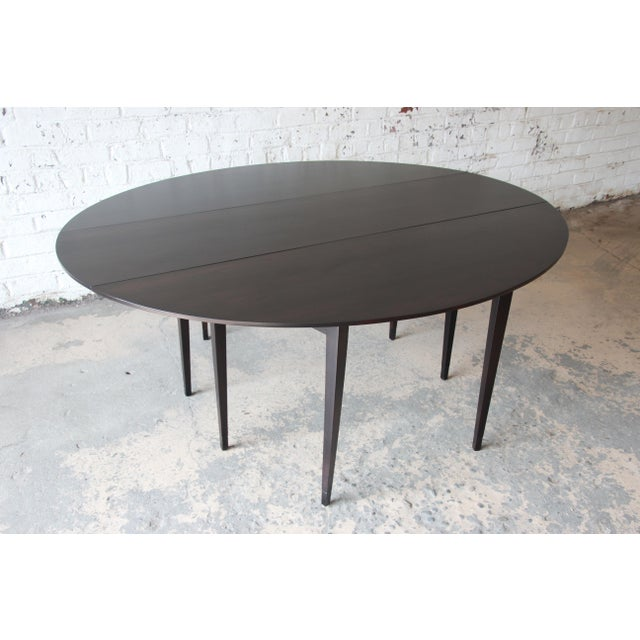 Offering an exceptional mid-century modern drop-leaf dining or console table designed by Edward Wormley for Dunbar...