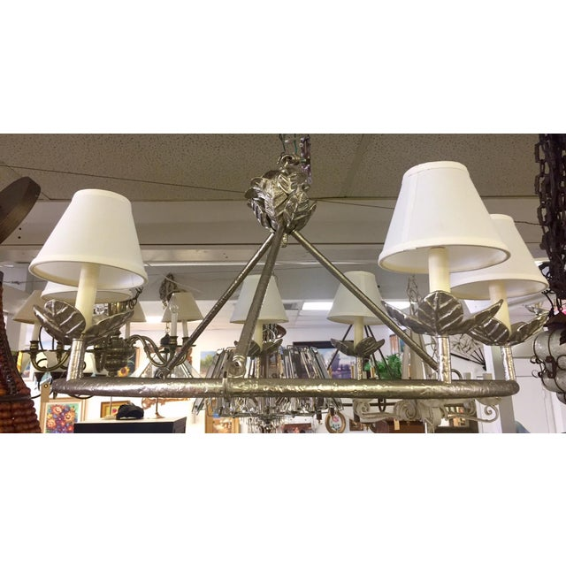 Beautiful hammered silver circular chandelier with six lightbulb sockets and petite lampshades. Made in the 1960s.