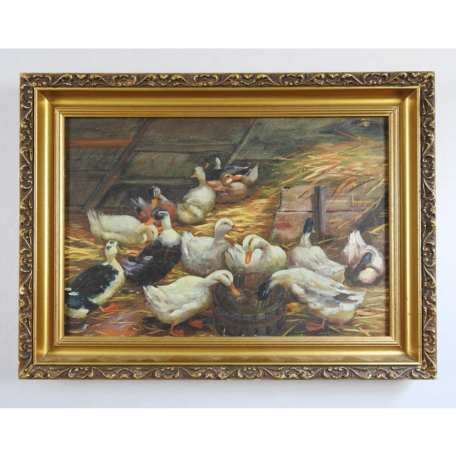 Antique oil on artist board of a group of ducks in the barn. Unsigned. Displayed in period giltwood frame, opening size...