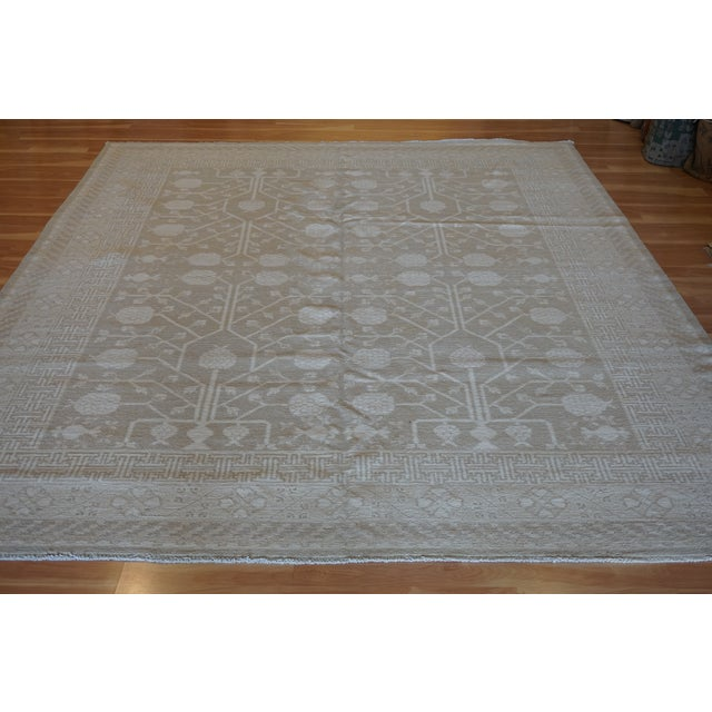 This is a handmade, Wool pile Khotan design rug, in size of 8 x 10 great addition to your home!