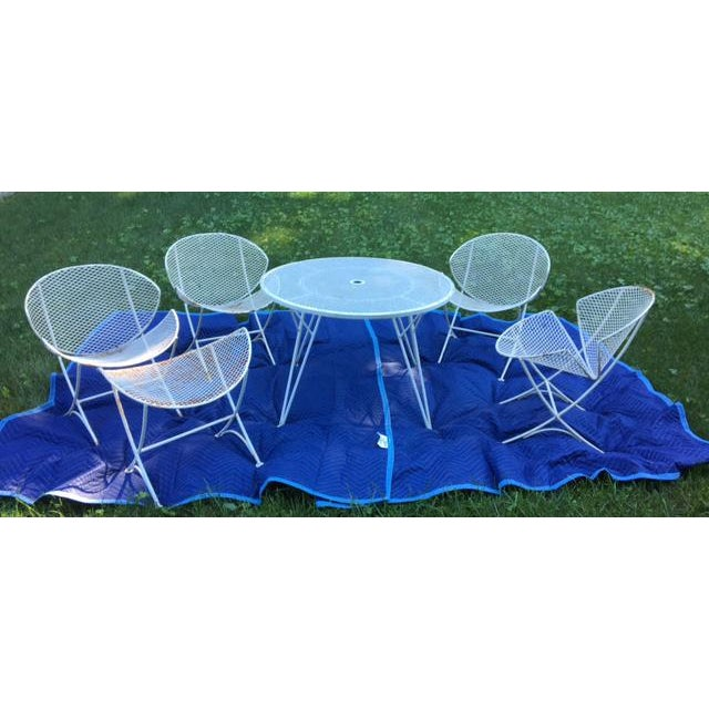 This fabulous set includes (4) four chairs, (1) table and (1) footrest - (5) pieces in total Please note: The set was...