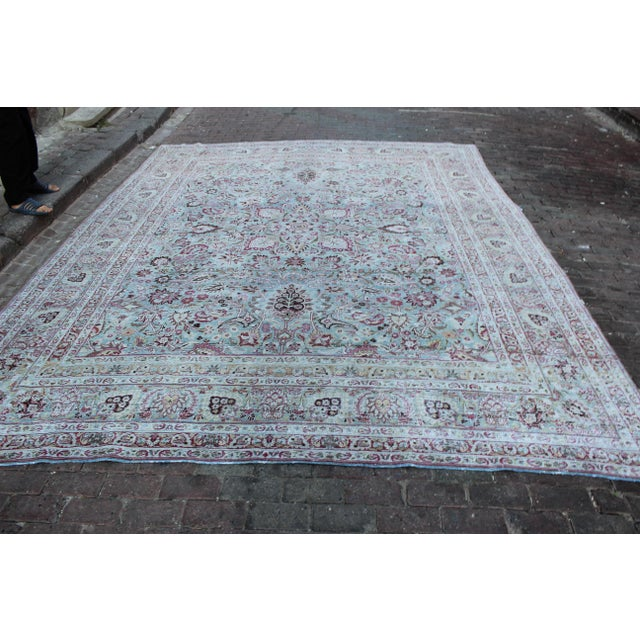 Vintage Mashad Persian Rug in saphire, rasberry, deep gray, magenta and splashes of straw hues. Rug has been shaved and...