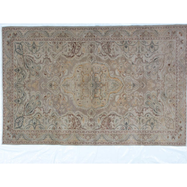 This masterpiece is a wool pile genuine handwoven Persian Tabriz rug. The piece features a thin pile.