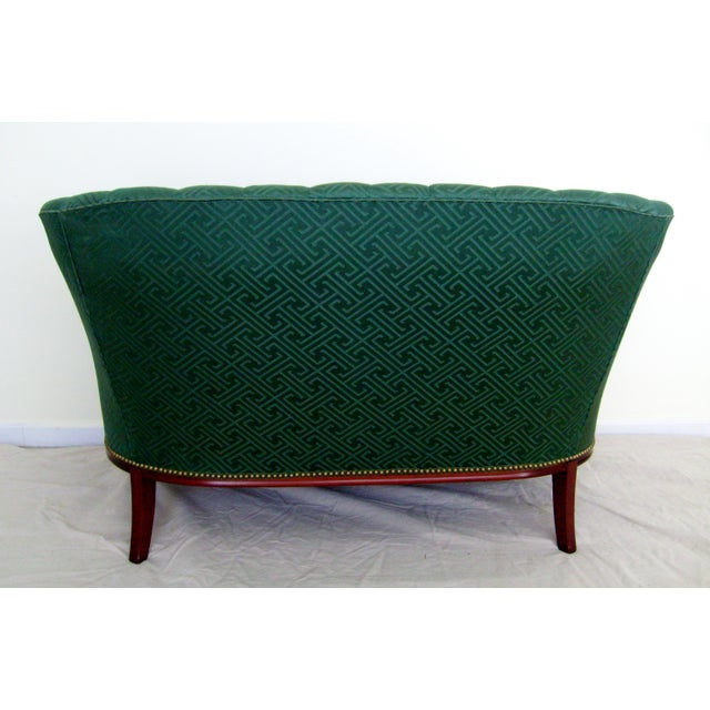 Dark jade green channel back settee with mahogany legs, trim and frame. Comfortable down filled bench cushion and brass...