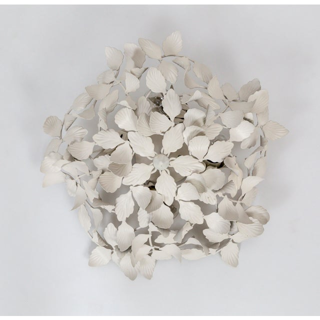 We have 3 vintage, white, painted metal pendant lights in a leaf cluster design. They work beautifully on the ceiling or...