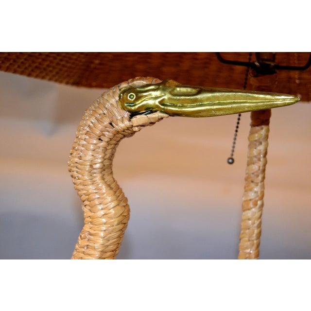 Mid-Century Modern Mario Lopez Torres Egret Bird Wicker, rattan table lamp. Featuring brass beaks, eyes and metal feet....