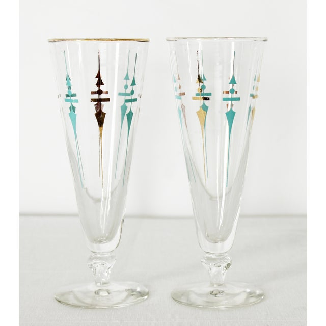 Pretty aqua blue detail make these glasses a fun addition to your bar or kitchen cabinet! There used to be a gold detail...