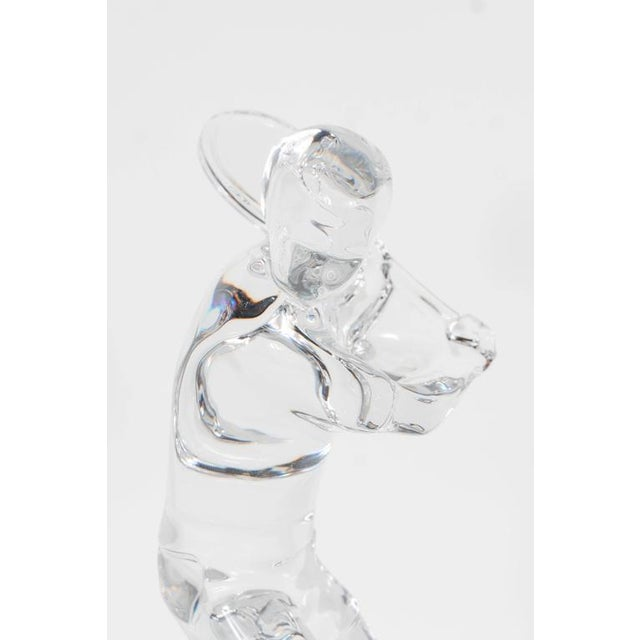 A Baccarat figurine depicting a tennis player preparing to hit a one-handed backhand. This would be a perfect sculpture...