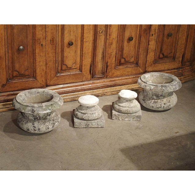 These classic antique carved stone garden vases are from a property in Bordeaux, France and date to the 19th Century (we...