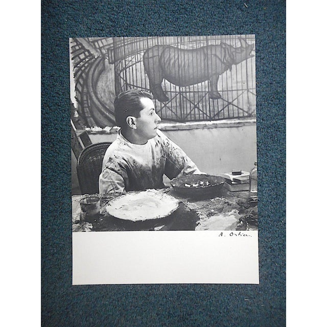 This photographic print was pulled from a French mid century art journal depicting circus clowns by the well listed mid...
