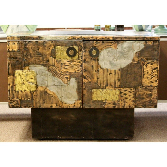 For your consideration is a luxe looking cabinet credenza, with a removable slate top on patchwork copper and steel sides,...
