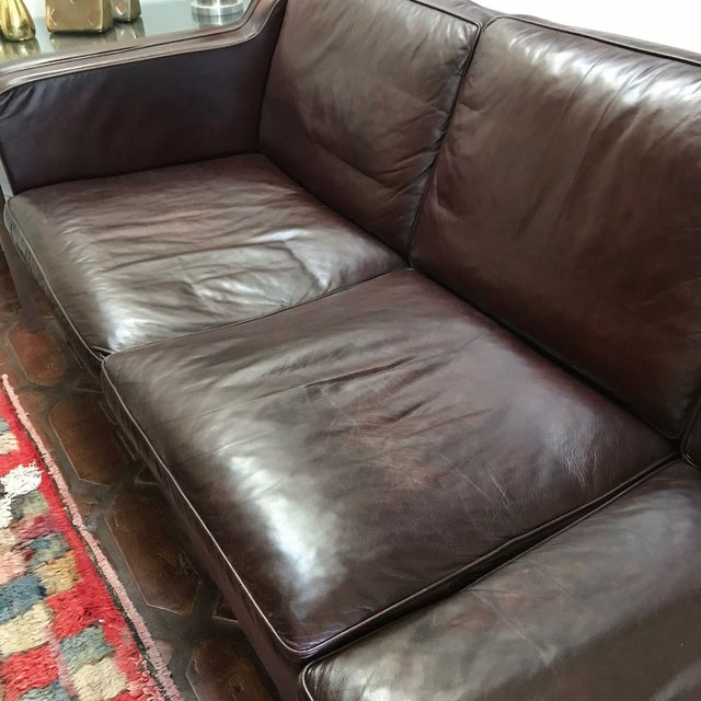 A dark brown leather Børge Mogensen sofa. Circa 1960s.