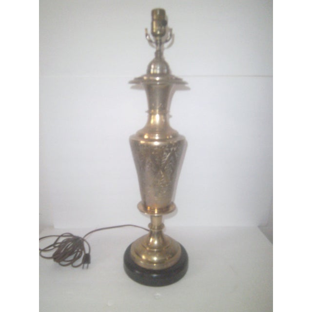 A beautiful hand tooled solid brass jardinière lamp on a lacquered wood base circa 1960. The overall condition is very...