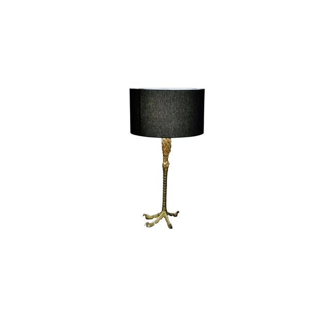 Lamp is made of brass with a gold overlay. Excellent condition – wear consistent with age.