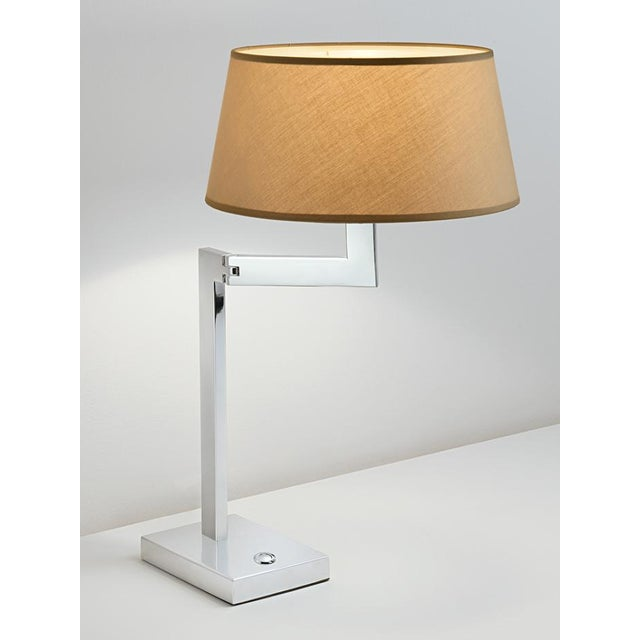 Chrome swing desk lamp with robust detailed hinges allowing arms to swivel. Price includes shade. Also available in brass....