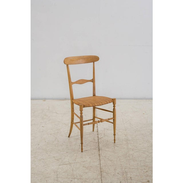 An elegant model Campanino chair by Chiavari, made of a turned beech frame with a cane seating. This slim and light chair...