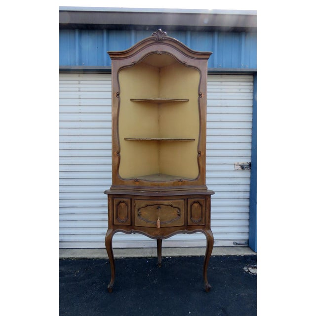 Antique Louis XVI style corner etagere with two shelves over one drawer.