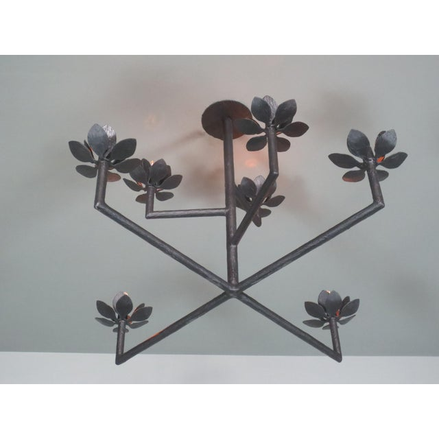 Seven flowers/ lights plaster and steel multi armed pendant chandelier with a Matte Black finish. May include ball,...