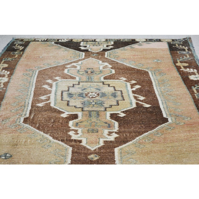 Vintage Kurdish tribal hand made rug with medallion pattern,soft texture and natural colors.