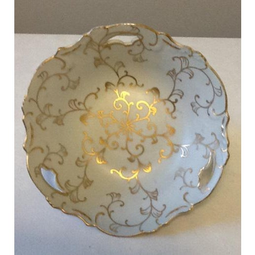 This pretty porcelain pedestal bowl painted by hand in the palest of blues will transform your table with its gorgeous...