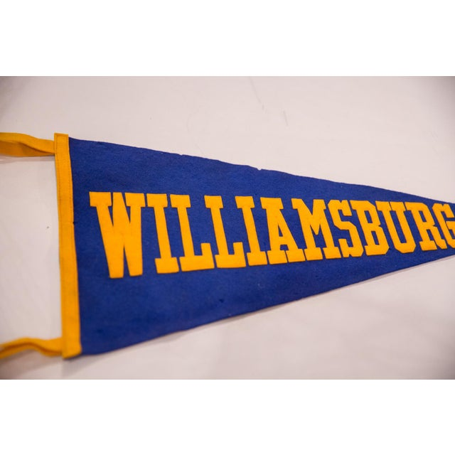 :: Vintage circa 1930s Williamsburg handmade felt flag pennant with blue and yellow gold coloring and large block letters....