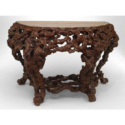 Pair of Asian Chinese Rustic style root console tables with shaped top above a pierced frieze on similar supports joined...