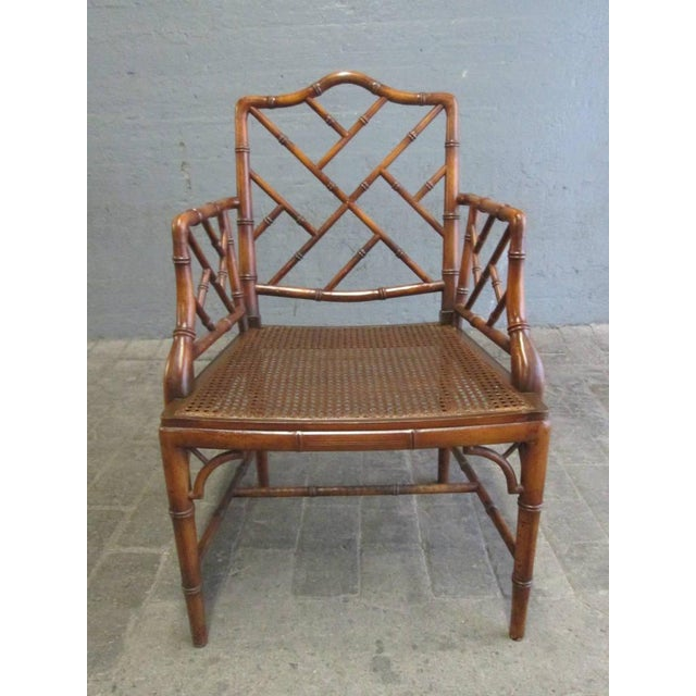 Pair of Chinese faux bamboo Chippendale style armchairs. Has cane seats.