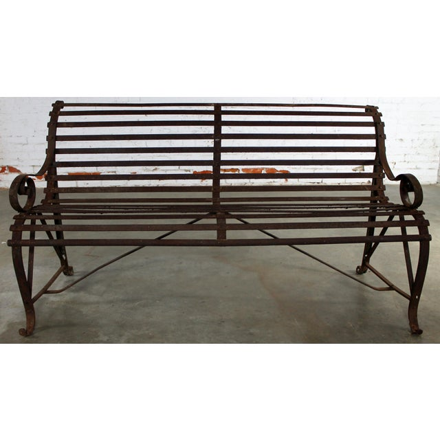 Incredible antique 19th century forged strap iron and slatted garden bench. It has loads of wonderful rusty iron patina...