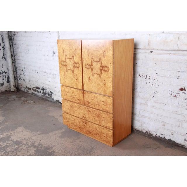 An outstanding Milo Baughman style mid-century modern burl wood gentleman's chest by Lane Furniture. The dresser features...