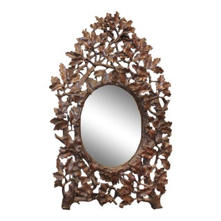 French Black Forest 19th Century Oak Leaves Carved Mirror with Oval Glass For Sale