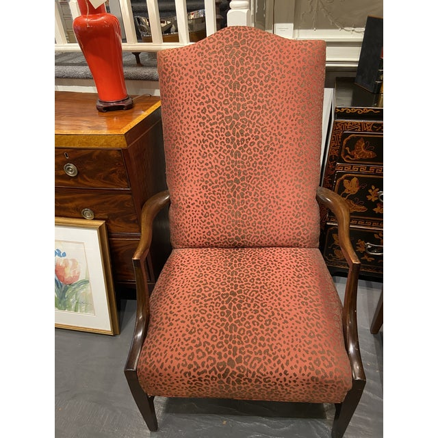 This is a gorgeous 19th century lolling chair. The frame is solid mahogany. The chair has beautiful vintage faux ocelot...