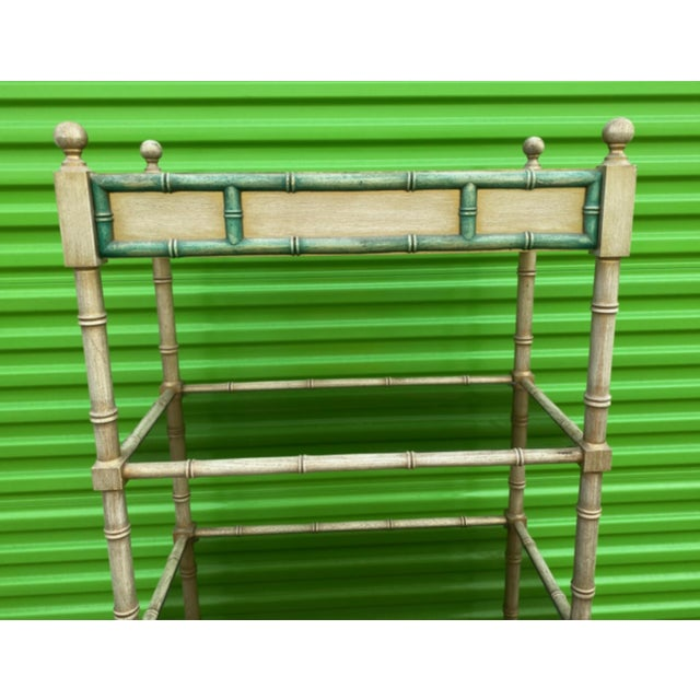 Mid-century modern painted wooden faux bamboo etagere with smoked glass shelves.