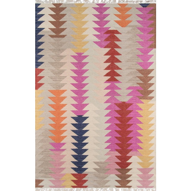 Bright fun colors give a modern twist to the traditional kilim patterns found in the Caravan Collection. Hand woven in...