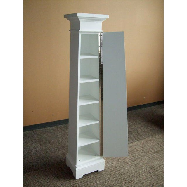 """Custom architectural column cupboards in a white painted finish. One size available: Small column cupboard-$1,700, 66"""" H x..."""