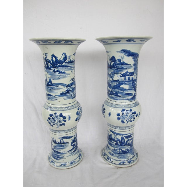 Pair of large blue and white Chinese trumpet vases.