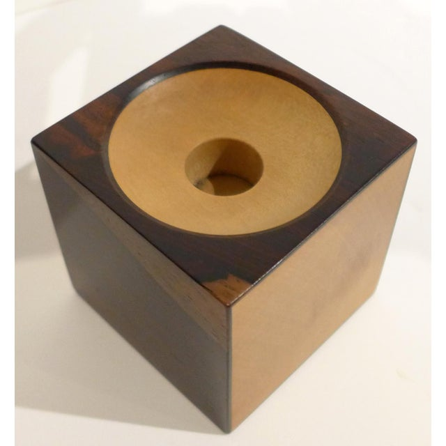 Small candleholder by renowned British woodworker and furniture maker John Makepeace (b. 1939), made of rosewood and ash,...