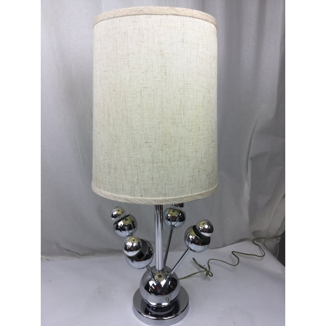 Vintage Atomic four arm chrome finish Mid-Century Modern, late 1950's table lamp. Lamp takes 100W bulb and four small 40W...