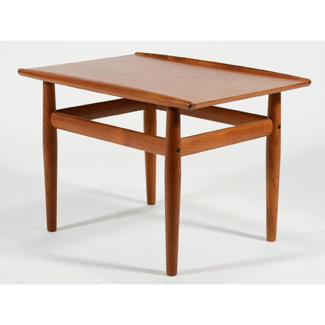 This classic Danish design by Greta Jalk has several fine details including solid edges with raised lips on two sides and...