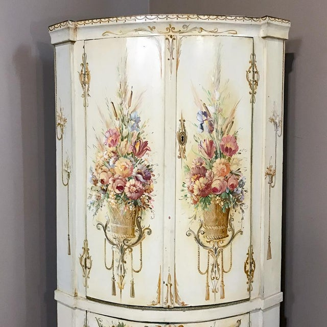 19th Century Swedish Painted Corner Cabinet features an elegantly bowed facade lavishly hand-painted with colorful floral...