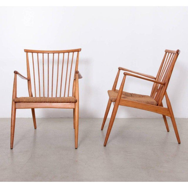 Excellent pair of German studio lounge chairs with papercord seats and solid ash frame.
