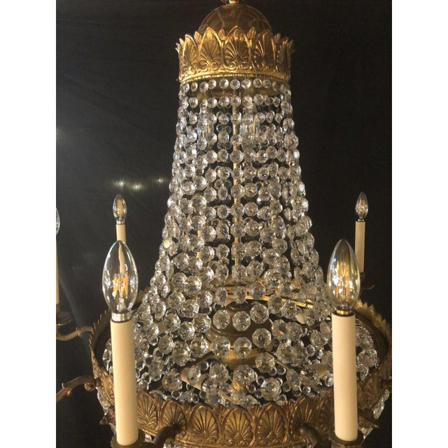 Large impressive 1920's Louis XVI style bronze and crystal chandelier. Ten lights on the outside and eight on the inside....