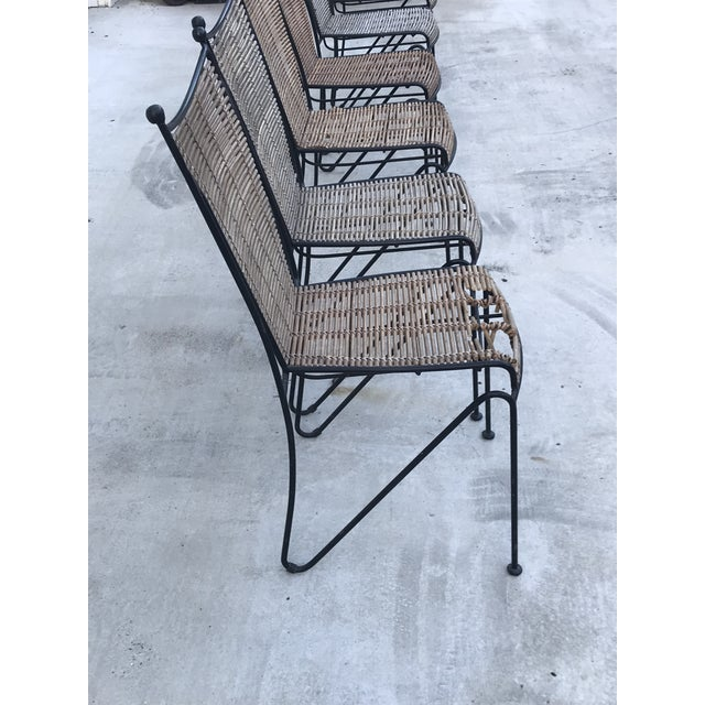 Fabulous design from Ficks Reed. Mid-Century Modern set of 6 pencil reed and wrought iron chairs. Could be used on a...