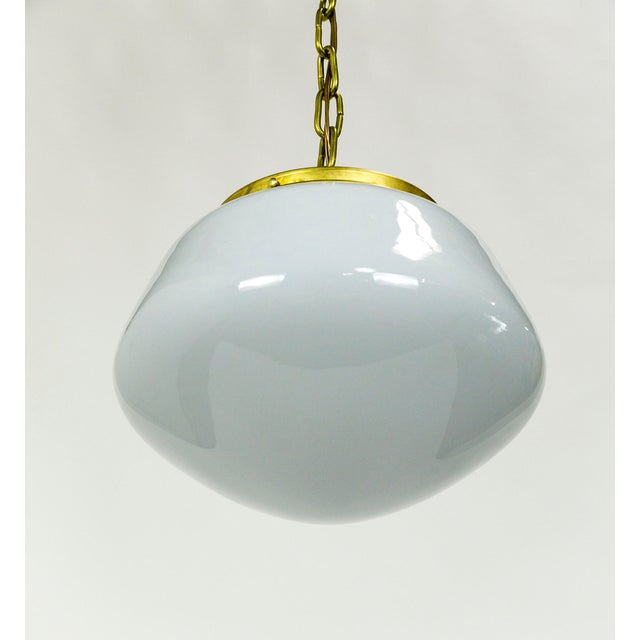 This Schoolhouse pendant light has an appealing shape and robust appearance. It is a versatile piece that will compliment...