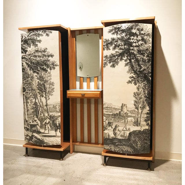 Incredible and rare wall-mounted entryway furniture piece by Enzo Strada with vanity mirror and drawer as well as rotating...