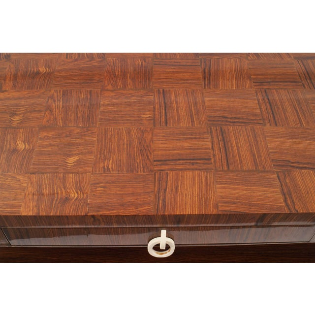 French midcentury 1950s rectangular rosewood coffee table with square legs supporting a shelf and a checkerboard design...