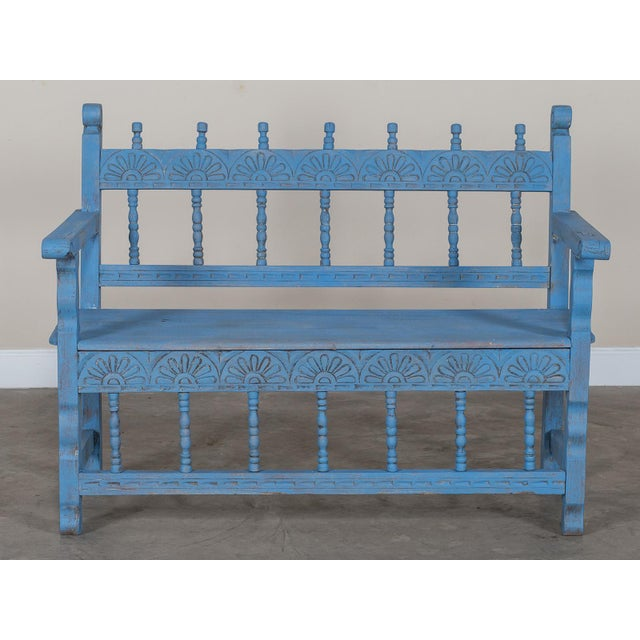 The cheerful colour and design of this antique French bench circa 1890 makes it a desirable addition to any casual space....