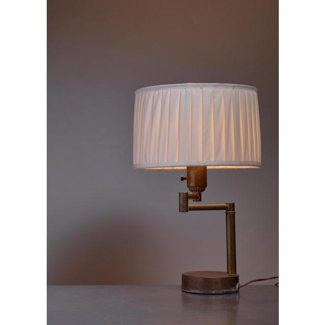 Distinguished walter von nessen swing arm table lamp in brass walter von nessen swing arm table lamp in brass american 1950s image aloadofball Images
