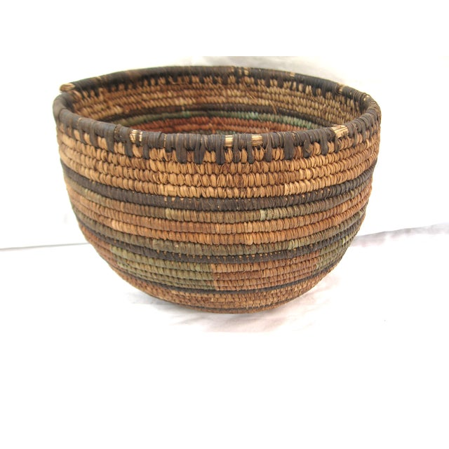 Lovely hand woven basket shows true age and character. Wonderful addition to your home.